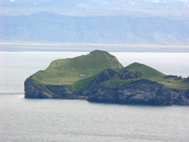 "This house located on Iceland and is in a perfect zombie fortified location. The house was given to Bjork from Iceland as a ""thank you"" for putting Iceland on the international map. But she never accepted the gift because of public outrage."